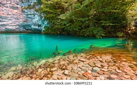 Blue lake in Abkhazia in summer