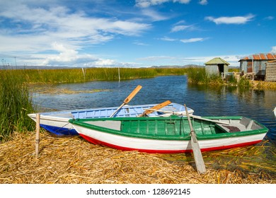 Blue lake with boats at the shore, titicaca lake