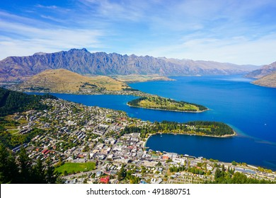 The blue lake and clear sky with beautiful town view from Skyline Gondola, Queenstown, New Zealand