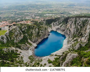 Blue Lake (Croatian: Modro jezero or Plavo jezero) is a karst lake located near Imotski in Croatia. It lies in a deep sinkhole possibly formed by the collapse of an enormous cave.