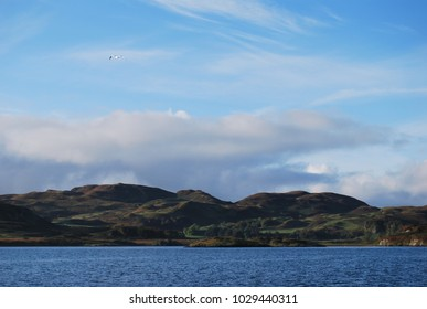Blue Lake in Front of Brown Scottish Highland Landscape