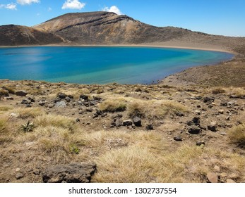 Blue lake on famous hiking trail Tongariro Alpine Crossing in North Island, New Zealand, popular one day hike for tourists and backpackers in Tongaririo national park, near to Taupo or Turangi city