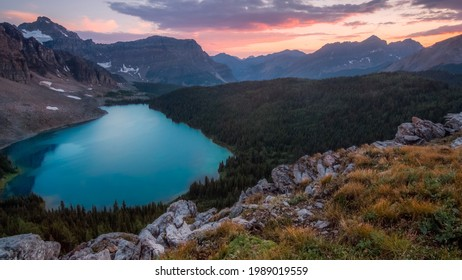 blue lake on the sun set lighting. forest and mountian landscape.