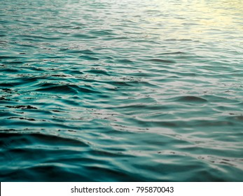 Blue Lake With Smooth Waves at Sunset Shiny Light