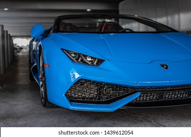 Blue Lamborghini Huracan Spyder parked in a parking garage with the top down in Las Vegas, Nevada / USA - July 1st, 2019