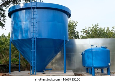 blue large fresh industrial water tank in rural area