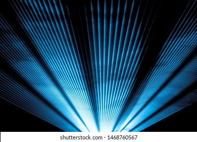 Blue laser show nightlife club stage and shining sparkling rays. Luxury entertainment in nightclub event, festival, concert or New Years Eve. Ray beams are symbol for science and universe research