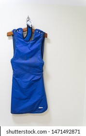 Blue lead apron and blue thyroid shield used for protection from x-ray machines.