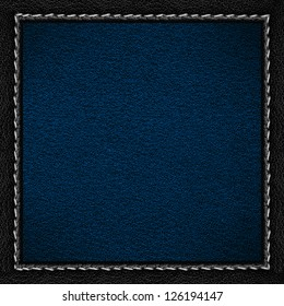 blue leather background in black leathery frame with seam