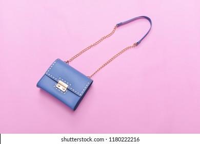 Blue leather handbag isolated pink background