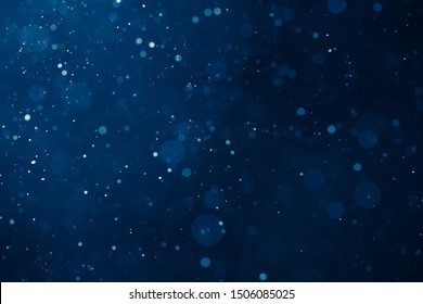blue light background with snowflakes particles