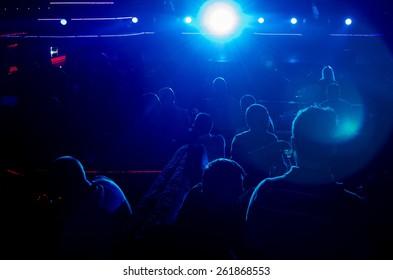 Blue light illuminates the lens at the disco club