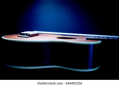 The blue light from the top shine to the body of Ukulele in the dark