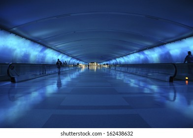 The Blue Lighted Tunnel in Detroit Metro Airport complete with commuters and moving sidewalks