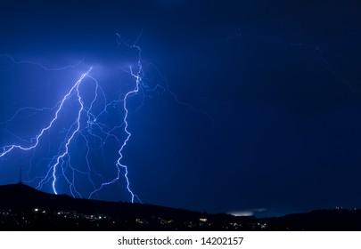 blue lightning over city landscape 2