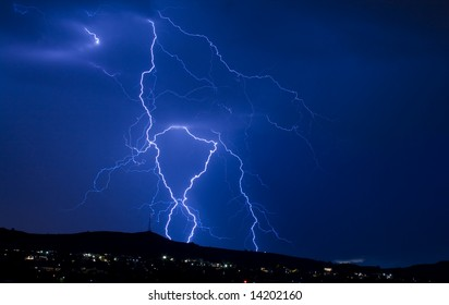 blue lightning over city landscape