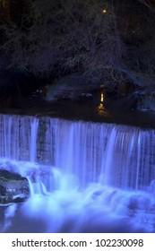 Blue lit waterfall at nigh