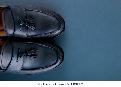 Blue loafer shoes on blue background. One pair. Top view. Copy space