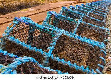 Blue lobster pots on harbour side