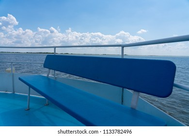 Blue long bench on the ferry boat.