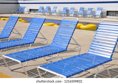 Blue lounge chairs along a lazy river.
