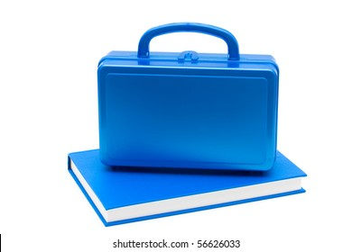 Blue lunch box with a blue book isolated on white, School Lunches