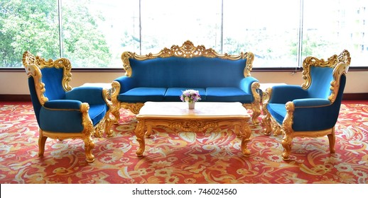 Blue luxury sofa on a red carpet