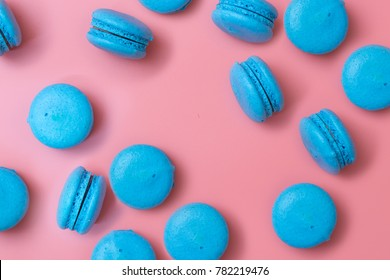 Blue macaroons on pink background.