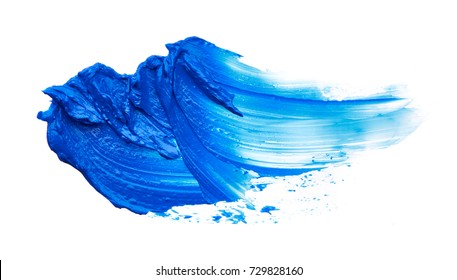 Blue makeup smear of creamy eye shadow isolated on white background. Blue texture of creamy eye shadow isolated on white background