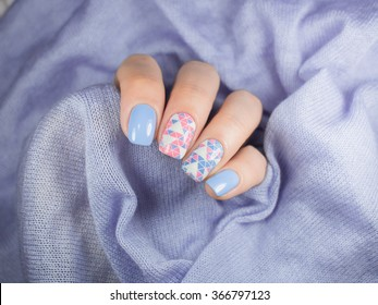 Blue manicure and nail art with triangles