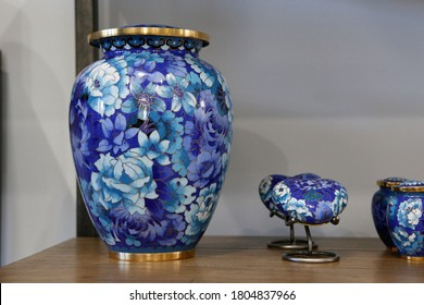 Blue marble adult options cremation urns on a wooden surface