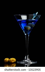 Blue martini with olives on black background