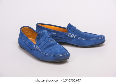 Blue men's loafers. Men's shoes on a white background. Colored moccasins