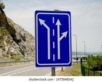 a blue metal rectangular traffic sign
