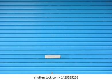 Blue metal roll up door background
