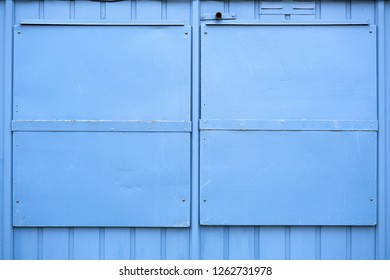 blue metal shutters on a house