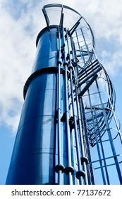 blue metal tank in sky