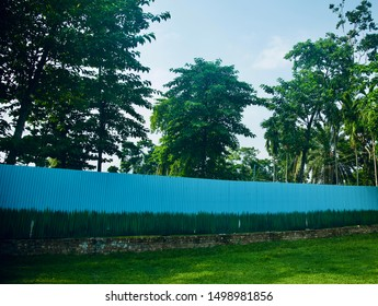Blue metallic boundary wall with green textures unique photo