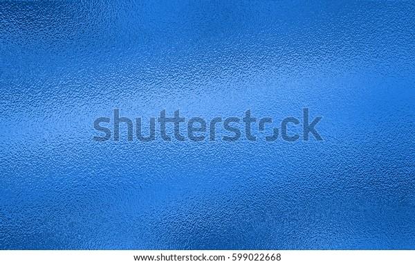 Blue metallic foil paper texture decor background.