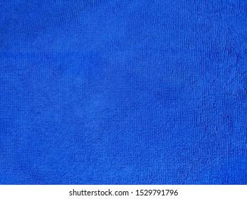 Blue microfiber clote texture close-up.