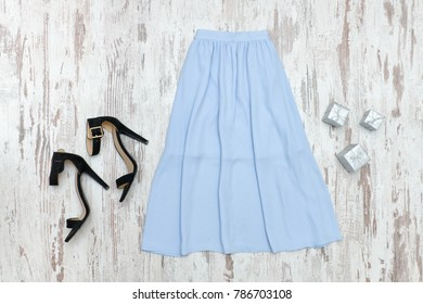 Blue midi skirt and black shoes. Fashionable concept