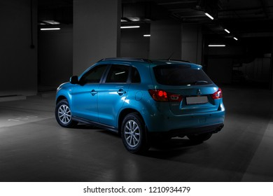 Blue Mitsubishi ASX, Model 2013 - April 2016: ASX Mitsubishi SUV picture taken in Parking slot in Abu Dhabi UAE with Studio Lights