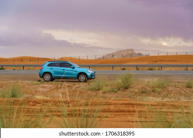 Blue Mitsubishi ASX SUV Model 2013. Desert Highway, Dubai - March 2020