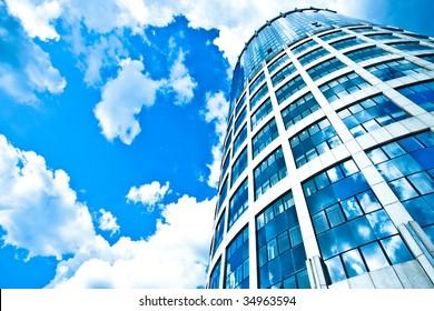 Blue modern office skyscraper on sky