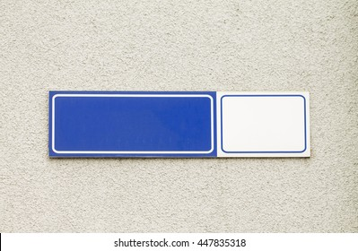 Blue modern styled house nameplate empty white space for number and text with street name on the concrete wall background