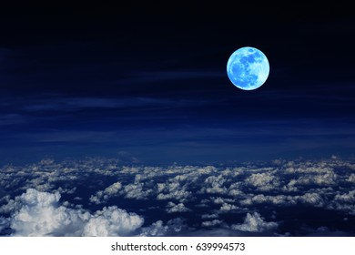 Blue moon and cloud  in the dark sky at night , color effect