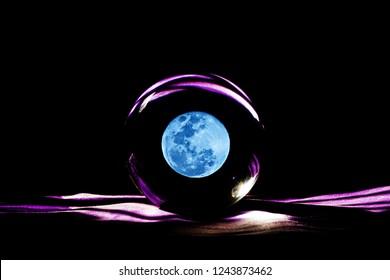 Blue moon in magic glass ball,Fortune teller, moon power concept.