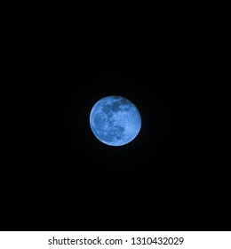 Blue moon sci-fi cinematic detailed photo through telescope of waning gibbous moon phase
