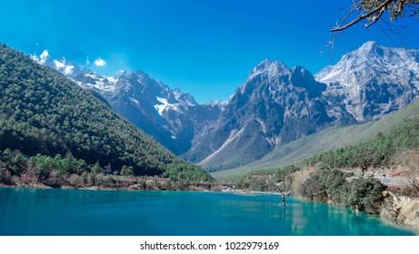 Blue moon Valley , Blue Water River waterfall and Jade Dragon Snow Mountain, Lijiang, Yunnan China.