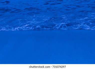 Blue moonlight colored waves of the ocean on a tropical beach. Equatorial islands in the centre of Indian Ocean. Best interior design ideas. Texture and Background